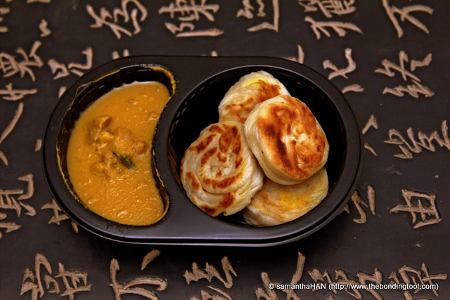 One section contained the curry dhal with a piece of chicken and the other, 4 pieces of prata.