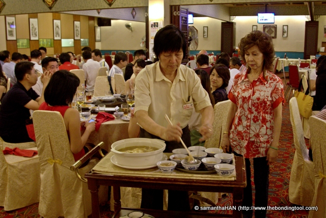 Mrs Hooi supervising the distribution of soup dish.<br />Soup plays a very important part of Chinese culinary culture. Even if a child does not eat at home, mommy dearest will always keep a bowl of soup for him/her.