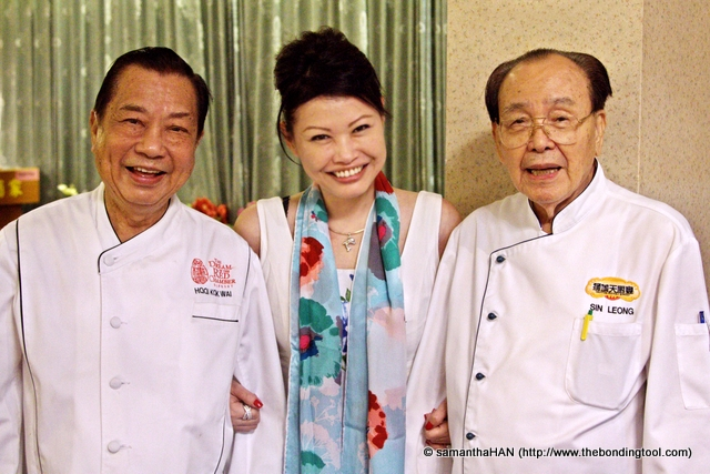 "The two (remaining out of four) heavenly Master Chef Hooi Kok Wai (my right) and Master Chef Sin Leong have titles like PBM after their names. <br />When taking this photo, they asked me, ""西瓜甜不甜?"" (Is the watermelon sweet?)<br />To which I replied, "" 甜!"" (sweet!). The equivalent of saying ""Cheese""<br />Of course!"