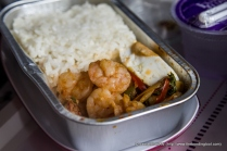 The other was Spicy Prawn with Rice and a quarter Salted Egg. And the steward continued to describe spicy prawn as dry version of Tom Yum Goong.
