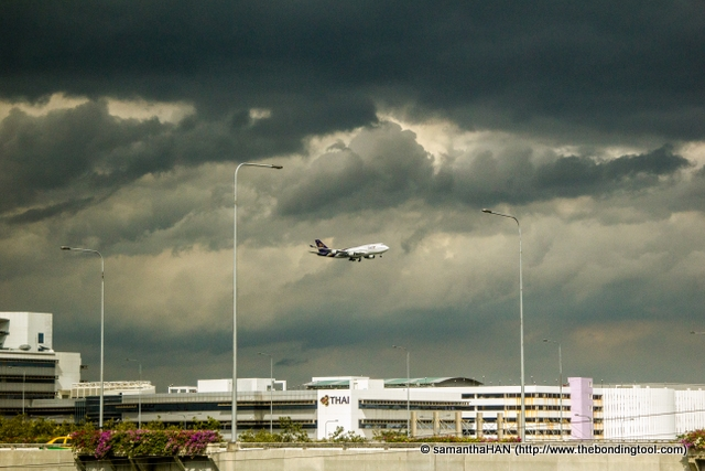 While the sky was blue when I departed Singapore, dark clouds loomed when we arrived in Bangkok's new Suvarnabhumi Airport.