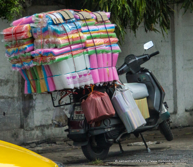 Overloaded motorcycles be it goods or humans are a common sight.