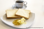 Very light toasts with marmalade and butter. Black coffee no sugar.