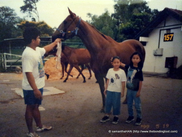 Valerie and Vanessa with one of our race horses in Bukit Timah a few months prior to its move to the new premise at Kranji in 1999.