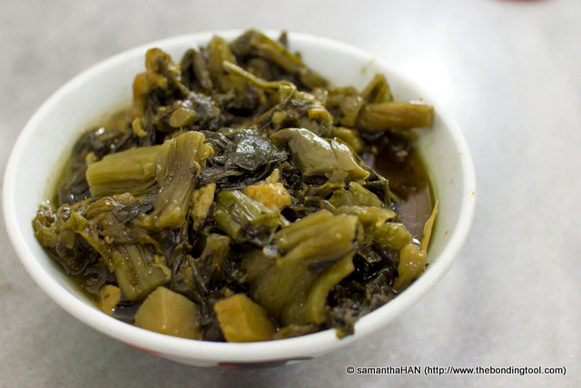 Preserved Mui Choy (Chye Buay) 梅菜尾.<br />This are preserved vegetables that are usually either heavily salted or sugared.<br />Most Bah Kut Teh Restaurants have them on menu as side dishes.