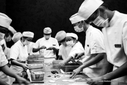 """This photo was shot from their menu. It showed the how food is prepared from the """"aquarium"""" kitchen."""
