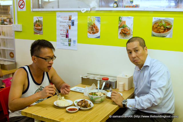 Gan and Marcus. Marcus saw seafood salad and asked if he could have seafood in his noodles but the server said no. So he ordered a fish ball curry noodle instead and we also settled for mango salad over of papaya.