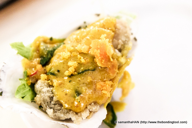 Deep-fried Oyster with Salted Egg Yolk.<br />Oysters... unabashedly an aphrodisiac, isn't it?<br />Coating seafood and vegetables with salted egg yolks has become quite the norm in Singapore and Malaysia.<br />All said, I still prefer to have live oysters served raw with lemons and some original tabasco sauce.