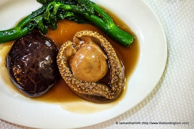 Stewed Whole South Africa Abalone with Japanese Mushroom and Kale.