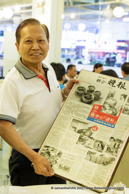 Mr. Ong Siong Lim showing us some newspapers' report of his culinary achievement stories.