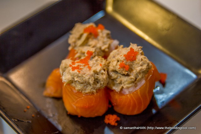 Tuna on sushi rice wrapped in salmon made by the chef. Plating was horrible and this was not acceptable in any respectable sushi house.