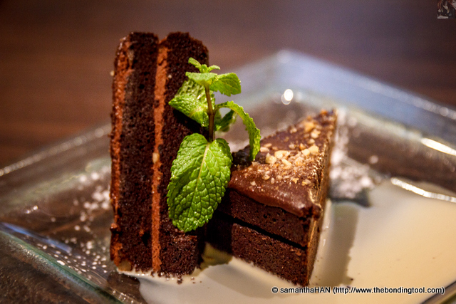 """Chocolate Hazelnut Cake.<br />The name speaks """"volume"""" for itself.<br />Perhaps it was not the pâtissier's fault as I did come with a full tummy and after pigging out the two rich desserts, I found this cake a little too dense for my uninspired palate."""