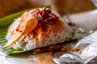 Nasi Lemak. By now you know the main composition of nasi lemak is the rice and sambal, usually with egg, fried anchovies and peanuts.