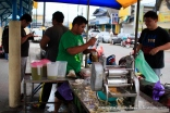 Adrian Ng at left getting some sweet sugarcane juice.