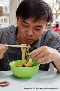 Paul having Prawn Noodle Soup.