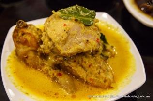 Ayam Masak Lemak Cili Padi meaning rich yellow curry chicken.
