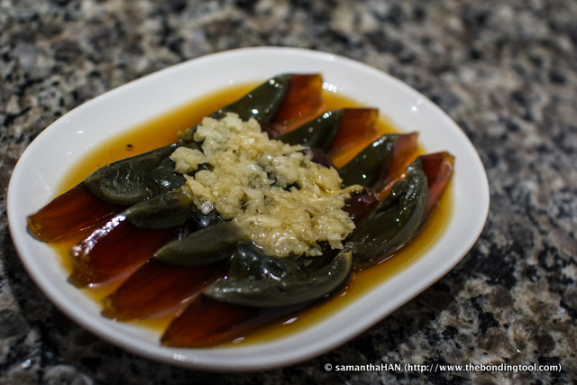 Century Eggs with pressed Garlic.