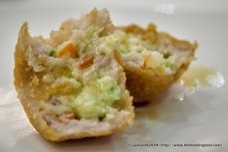 Mashed yam stuffed with diced seafood like scallops and prawns with a creamy centre.