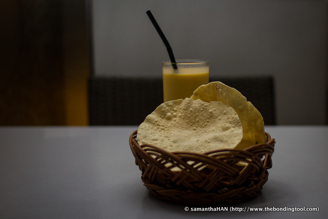Al had Mango Lassi (background).<br />Papadam is a thin, crisp disc-shaped Indian cracker, made from seasoned dough of black gram, and deep-fried fried. It is a common tidbit served before the main meal.
