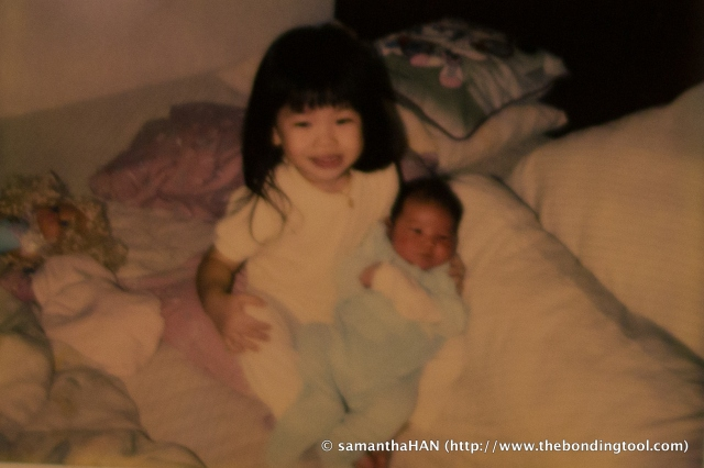 Valerie has always enjoyed her little sister. We had a little doll stroller which she would push Vanessa around.
