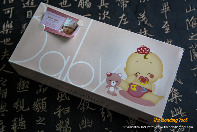 Chris gave me this for her first child's one month celebration. It came with a customised card with her child's photograph and name.