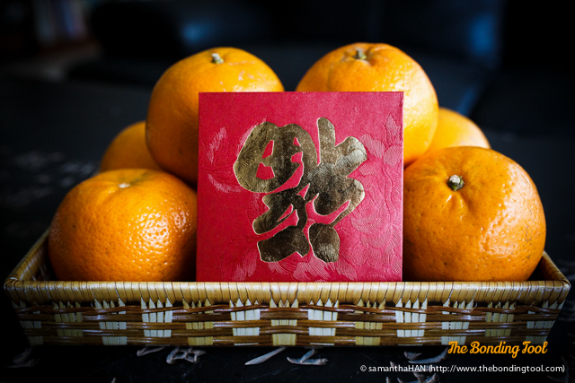 Mandarins represent Gold.  Have a Prosperous New Year everyone!