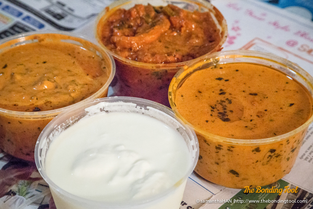 From top left, clockwise:<br />Butter Chicken S$16.90<br />Chicken Tikka Masala S$16.90<br />Dal Makhani Khaas S$12.90<br />Plain Yogurt S$4