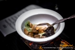 Les Champignons. Mushrooms simmered in a veal broth with black truffle.