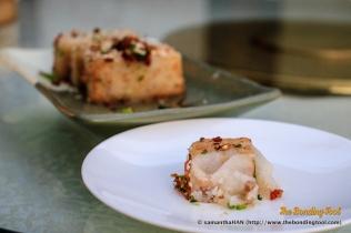 萝卜糕 - Radish Cake. It is also written as Turnip Cake in menu, sometimes.