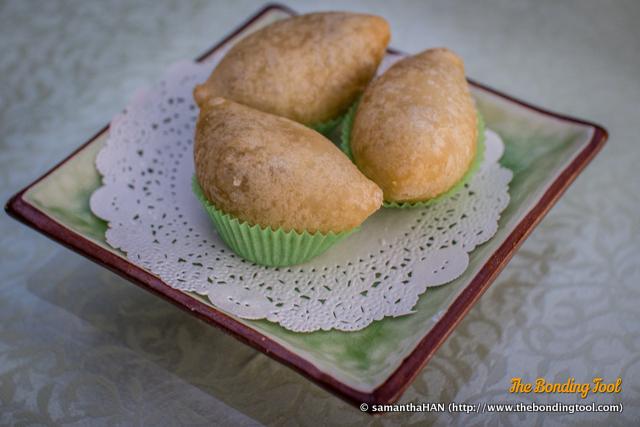 鹹水角 (Xian Shui Jiao in Mandarin or Ham Sui Kok in Cantonese) loosely translated as salt-water dumpling is deep fried oval shaped savoury dumpling made with sticky rice flour.