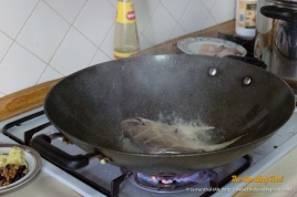 Adding a little salt in the oil will prevent the fish skin from sticking to the pan.