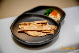 Toasted dried Kawahagi (Leather Jacket Fish) strips served with Japanese Mayonnaise topped with Tobiko.