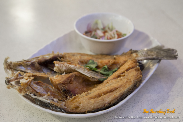 Deep-fried Sea Bass with Mango Salad Sauce. A common dish found all over Thailand.