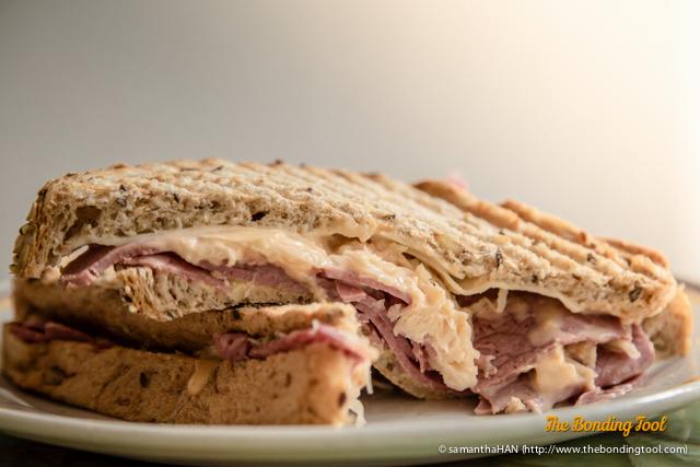 Reuben Sandwich - S$14.00 Corned Beef, Sauerkraut, Russian Dressing and Swiss Cheese.