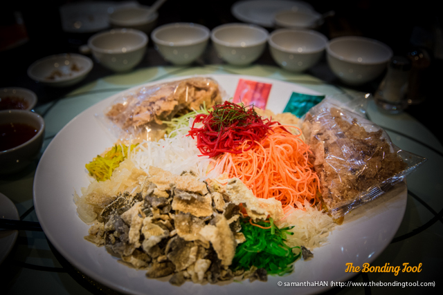 """This is a platter of Yusheng 鱼生.<br />It is originally a Teochew-style raw fish salad.<br />""""Yu 鱼 (fish)"""" is commonly associated with its homophone """"abundance (余)"""" while """"Sheng 生 (raw)"""" sounds like """"rise (升)"""".<br />Hence, Yusheng is interpreted as a homophone for """"余升"""" meaning an increase in abundance."""