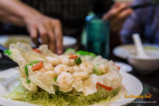 Sauteed fresh Shrimps in crispy Noodle Basket.