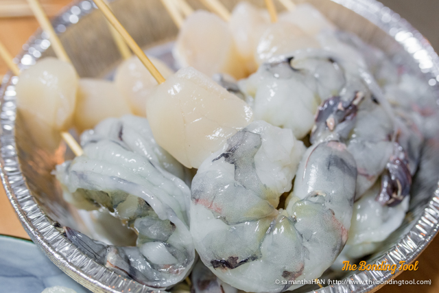 Prepared Jumbo Prawns and Scallop Skewers.