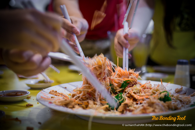 We all tossed the ingredients with chopsticks and it does get messy but the higher the toss, the greater the luck so no one minded.
