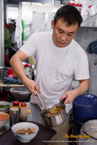 Max heating up the traditional herbal Hainanese Mutton Soup.
