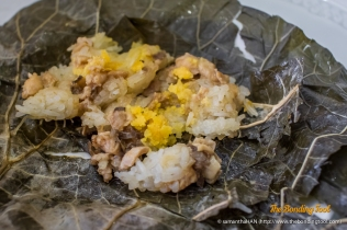 Steamed Glutinous Rice with Chicken, Mushrooms and Salted Egg Yolk Filling.