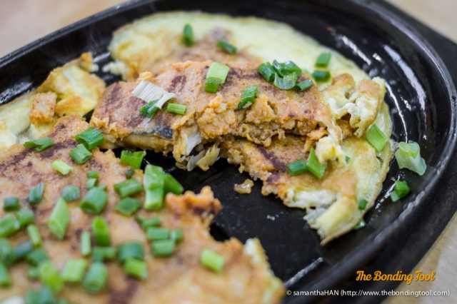 Hotplate Otak with chunky pieces of fish.
