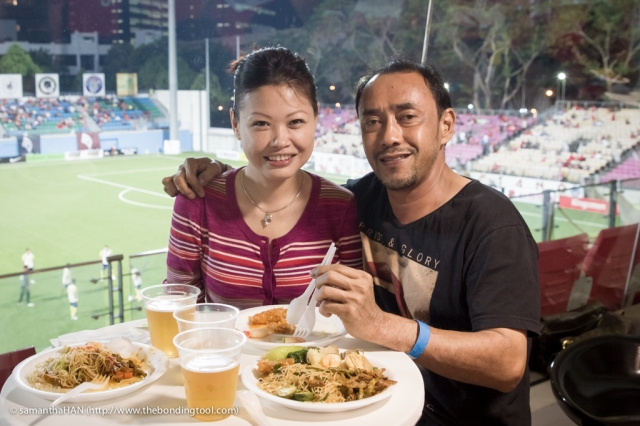 Yunos and I enjoying our dinner during the game's half time.