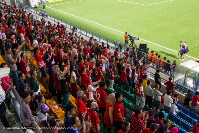 """Singapore supporters chanting """"Sin-ga-pore"""", """"Oleh, oleh, oleh, oleh"""" and doing the Singapore Wave during the match."""