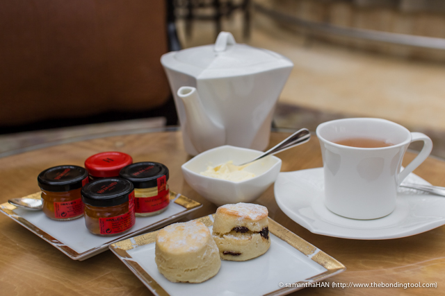 Jerry's Orange Pekoe came first. Look at the jam jars and then look at the scones.