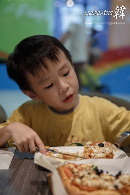 Zhi Qi enjoying his share of Pissaladiere.
